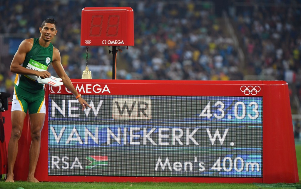 Van Niekerk sets world 400m record and Bolt wins third Olympic 100m title on dream night