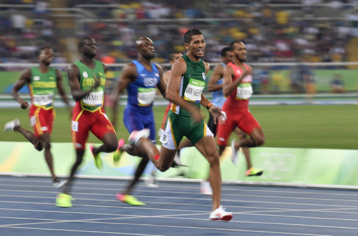 Wayde van Niekerk heads for an Olympic 400m gold medal and world record of 43.03 from the outside lane as defending champion Kirani James and LaShawn Merritt contest silver ©Getty Images