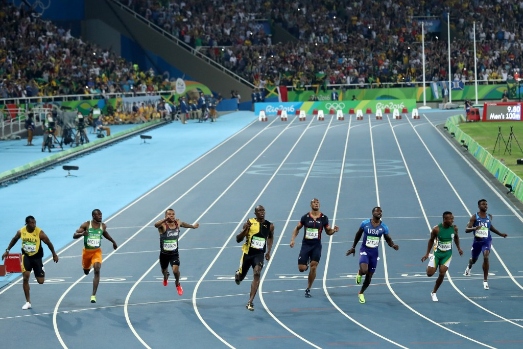 Usain Bolt wins his third consecutive Olympic 100m title in 9.80sec ahead of Justin Gatlin, third right, who clocked 9.89 and Andre de Grasse of Canada, third left, who took bronze in 9.91 ©Getty Images