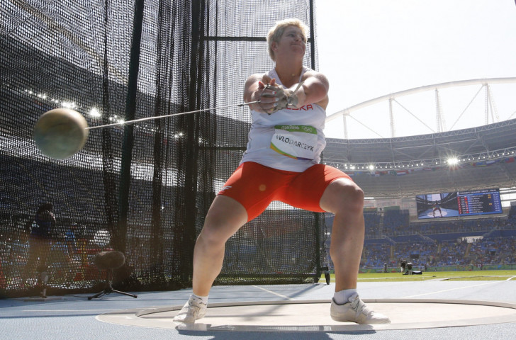Poland's Anita Wlodarczyk improved her world hammer throw record to 82.29m, earning an Olympic gold medal four years after taking silver at London 2012, and dedicated the victory to her late friend Kamila Skolimowska ©Getty Images