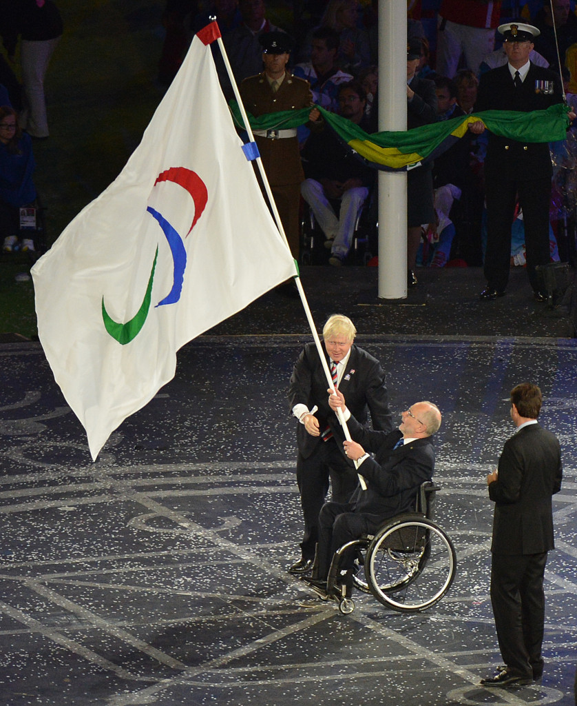 Rio de Janeiro Mayor Eduardo Paes, waiting to receive the Paralympic flag from Sir Philip Craven during the Closing Ceremony of London 2012, has promised to find funds for this year's event ©Getty Images