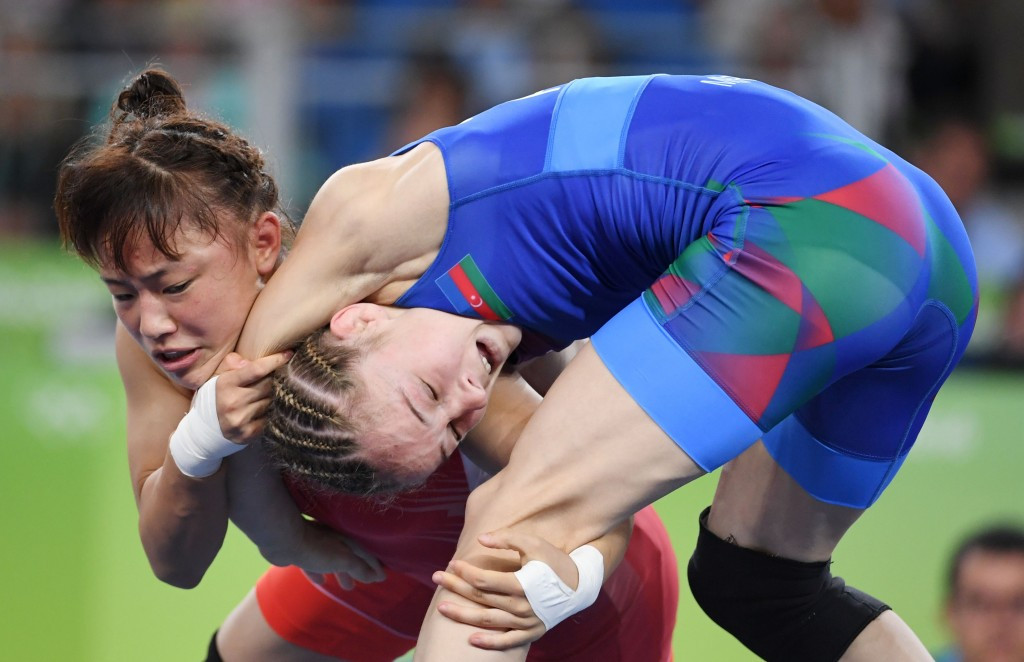 Eri Tosaka, left, came from behind in the final seconds to win the under 49kg gold medal contest ©Getty Images