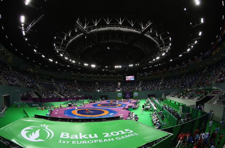 Azerbaijan and Russia scoop wrestling double after semi-finalists disqualified for brawling