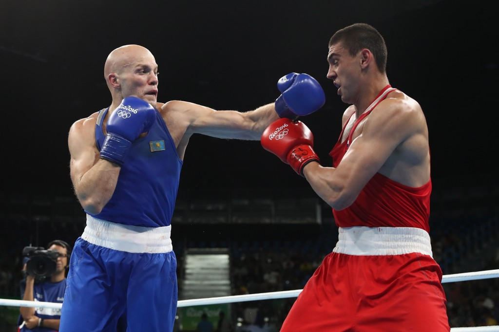 Russia's Evgeny Tishchenko (red) controversially won the Rio 2016 heavyweight gold medal with a victory which has come under scrutiny ©Getty Images