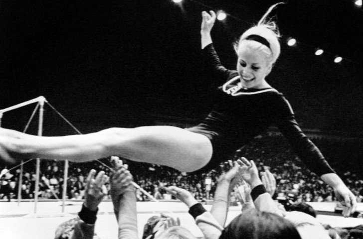 Vera Caslavska of Czechoslovakia is thrown into the air by supporters at the 1968 Mexico Games, where she won four gymnastics golds and two silvers - but her landing was harsh when she returned home, having made a podium protest against the ruling Soviet forces ©Getty Images