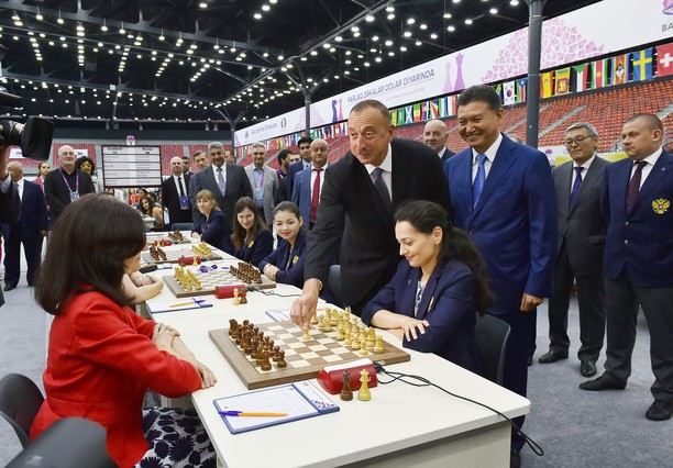 Azerbaijan's President Ilham Aliyev made the first move of the 42nd Chess Olympiad in Baku in a match between Russia's Alexandra Kosteniuk and Scotland's Ketevan Arakhamia-Grant ©President of Azerbaijan