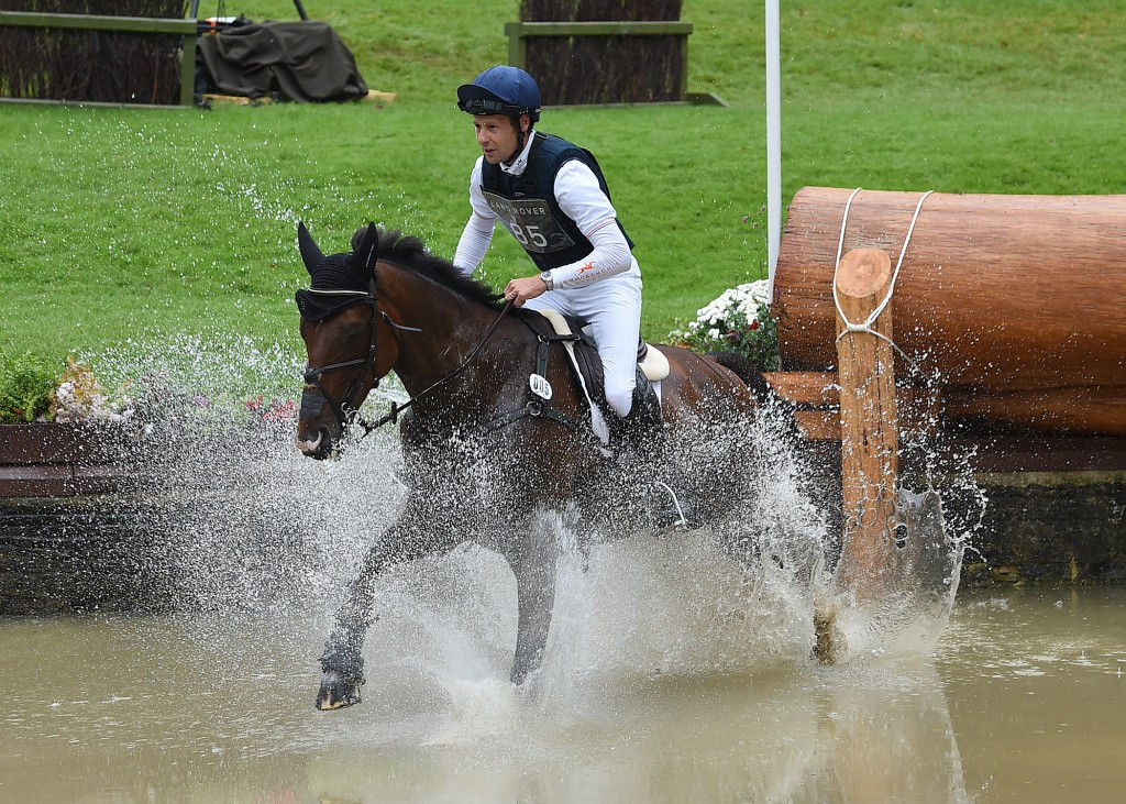 Burton maintains lead as riders struggle in cross-country section at Burghley Horse Trials