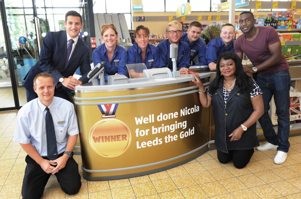 Aldi in Burley in Leeds, revealed its gold till in honour of Yorkshire doube Olympic boxing champion Nicola Adams, an event attended by her mother Dee, right ©Aldi
