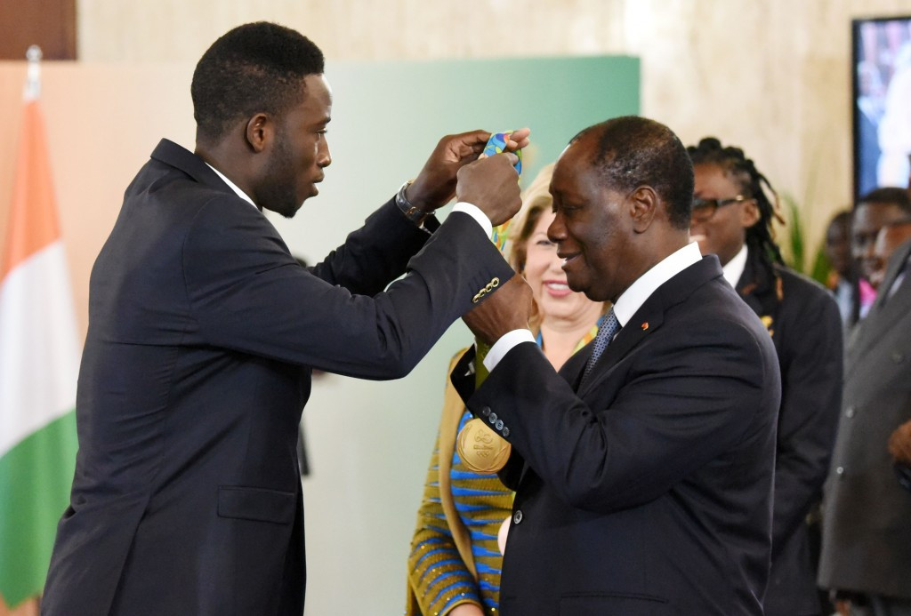 Cheick Sallah Cisse (left) was rewarded for his gold by President Alassane Ouattara (right) ©Getty Images