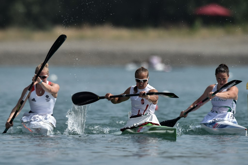 Renata Csay (Centre) of Hungary and South Africa's Hank McGregor won gold in their respective men's and women's kayak singles events at the 2016 ICF Canoe Marathon World Championships in Germany ©ICF