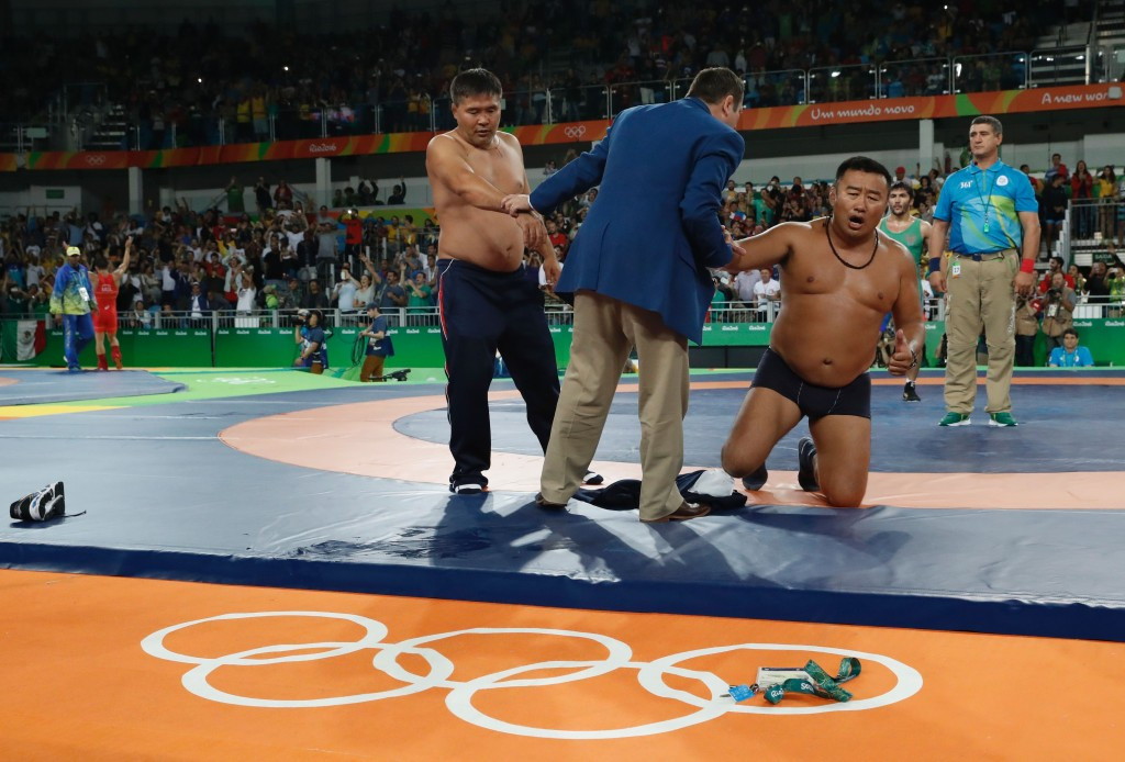 Mongolian wrestling coaches suspended for three years after removing clothes in protest at Rio 2016