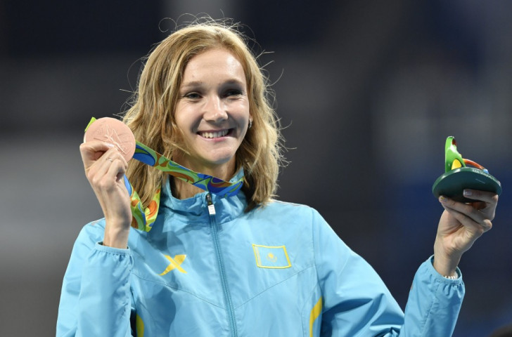 London 2012 triple jump champion Olga Rypakova of Kazakhstan, showing off her bronze medal from Rio 2016, now stands to add another bronze to her collection from Beijing 2008 ©Getty Images