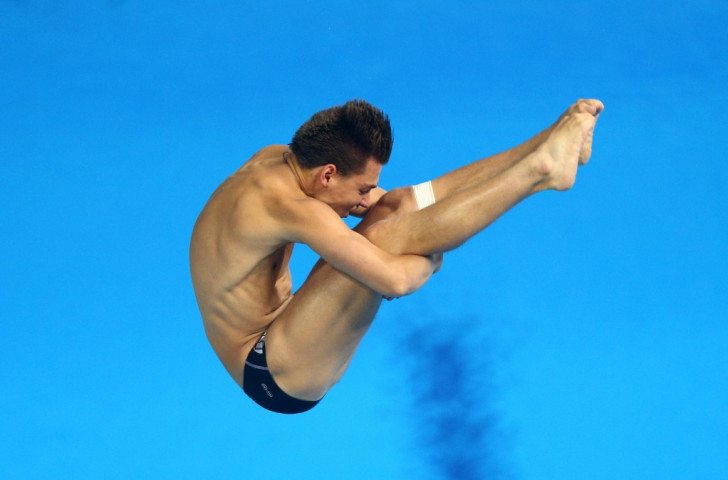 Italy's Ruslan Adriano Cristofori competes during the men's diving three metres springboard final ©Getty Images