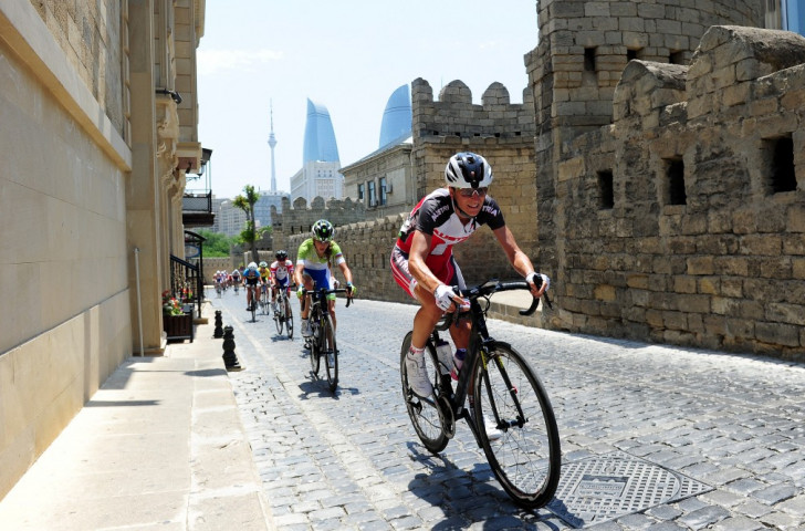 Austria's Martina Ritter leads a group of riders through the old town during the women's road race ©Getty Images