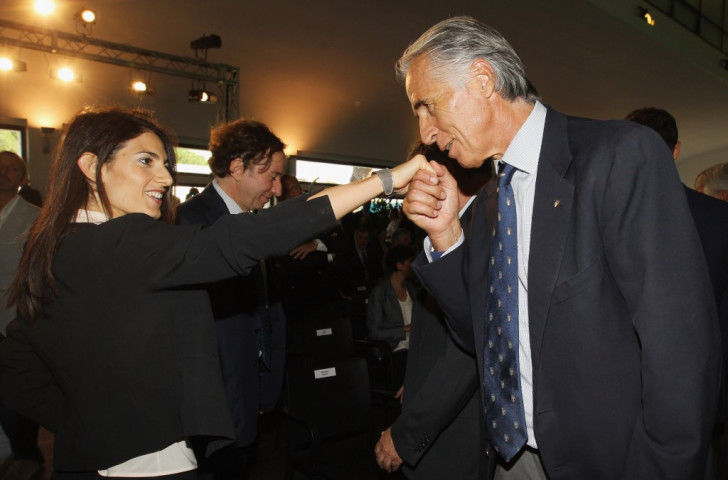 CONI President Giovani Malagò kisses the hand of Rome Mayor Virginia Raggi at an event last month shortly after she had refused to support the Italian capital's bid for the 2024 Olympics and Paralympics ©Getty Images