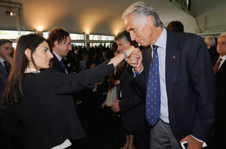 At the UEFA Roma 2020 official logo unveiling in September, the CONI President kisses the hand of the Mayor of Rome, Virginia Raggi, whose opposition to the Rome 2024 bid has pushed it to the brink of extinction ©Getty Images
