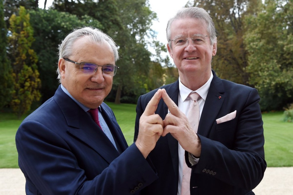 Paris 2024 co-chairman Bernard Lapasset, right, celebrates the new sponsorship deal with SUEZ chief executive Jean-Louis Chaussade, meaning the bid has now raised  €26 million in private sector funding ©SUEZ