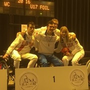 Emanuele Lambertini of Italy, centre, defeated Russia's Oleg Gavrilenkov in the final of the under-17 mixed foil competition at the IWAS Wheelchair Fencing World Championships ©IWAS
