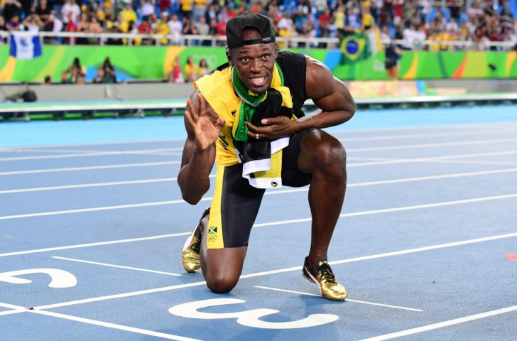 Usain Bolt celebrates winning a third Olympic sprint relay title from lane three at the Rio Games - now he has marked out his final race on home soil next year ©Getty Images