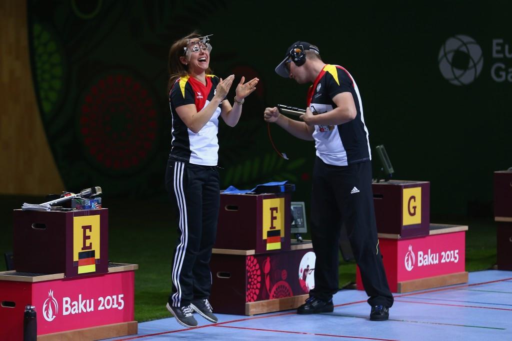 Germany's Monika Karsch celebrates with Christian Reitz after winning the final shooting gold medal of Baku 2015