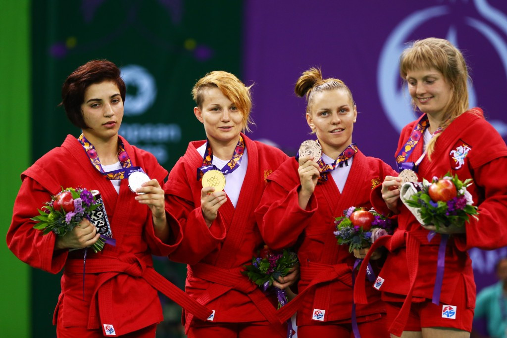 Anna Kharitonova (centre, left) won the first of Russia's five sambo gold medals ©Getty Images