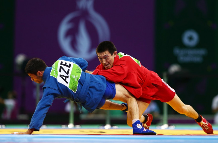 Russia's Aymergen Atkunov (red) got the better of Azerbaijan's Islam Gasumov (blue) in the men's under 57kg category final