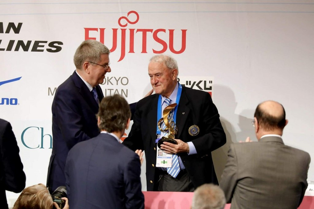 Bach awards IOC President's Trophy to departing FIG head Grandi at Congress