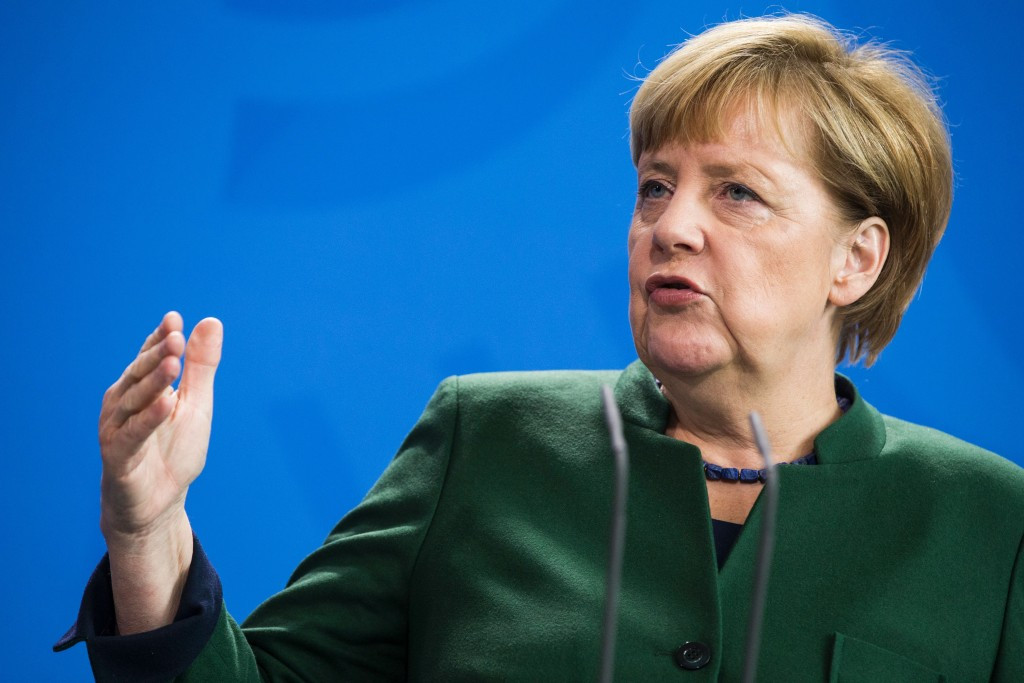 Sir Philip claimed in the phone call that German Chancellor Angela Merkel could not stand Thomas Bach ©Getty Images