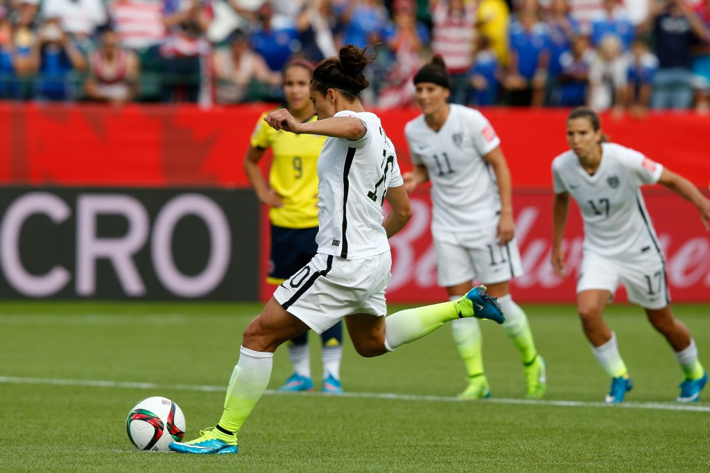 Carli Lloyd's second-half penalty and an earlier strike from Alex Morgan saw the United States reach the quarter-finals with a 2-0 win over Colombia