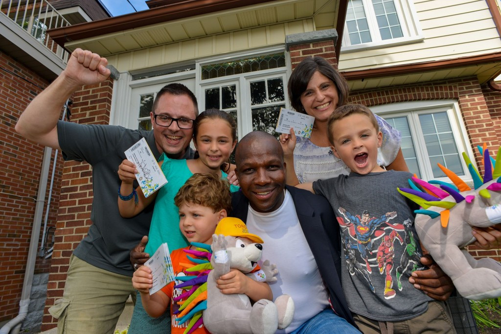 Double Olympic champion Bailey surprises family by delivering Toronto 2015 tickets to their front door