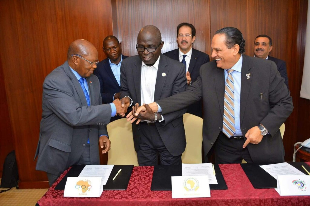 Ivorian Lassana Palenfo (left) alongside ANOCA and African Union officials ©ANOCA