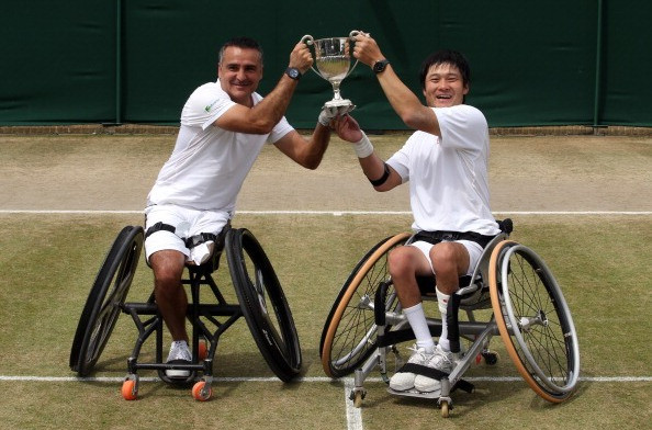 Stephane Houdet of France and Shingo Kunieda of Japan celebrate their Wimbledon doubles title in 2014 ©Getty Images