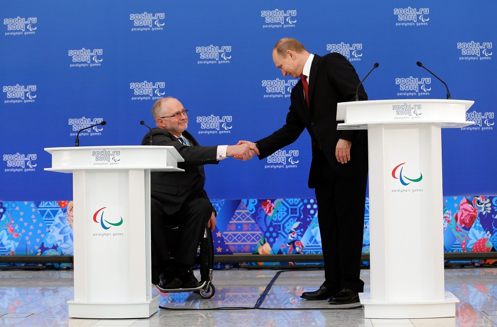 Sir Philip Craven (left, alongside Russian President Vladimir Putin at Sochi 2014), claimed Russia is still