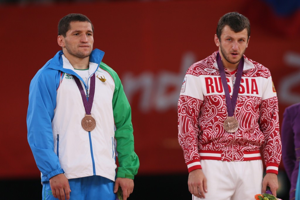 Soslan Tigiev (left) has now been stripped of medals won at two Olympic Games ©Getty Images