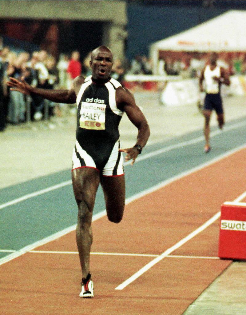 Donovan Bailey earns himself $1m for beating the distant figure of Michael Johnson in their 1997