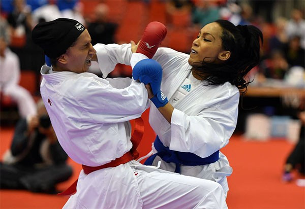 Lucie Ignace, right, helped France secure a place in the women's team kumite final on day three of competition at the Karate World Championships ©WKF