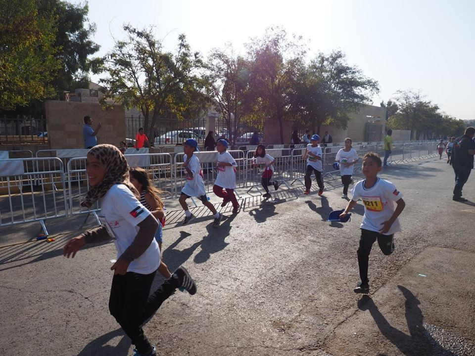 Taekwondo Humanitarian Foundation youngsters take part in children's race at Amman Marathon