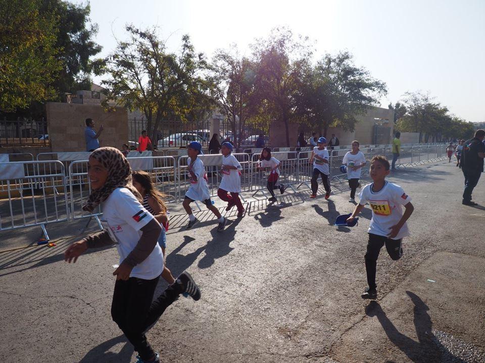 Taekwondo Humanitarian Foundation youngsters take part in children's race at Amman Marathon