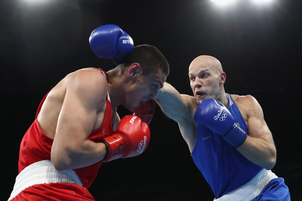 Evgeny Tishchenko, left, won the Olympic heavyweight final despite being on the back foot for most of the fight ©Getty Images
