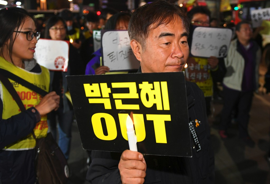 The revelations surrounding Pyeongchang 2018 come as protests continue against the South Korean Government ©Getty Images