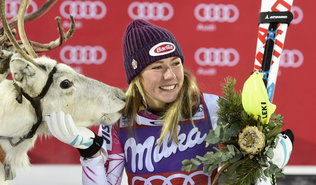 Mikaela Shiffrin celebrates her victory in Levi with a reindeer she was allowed to name ©Getty Images
