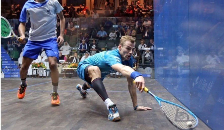 Nick Matthew (right) was pushed deep before completing a first round victory ©PSA