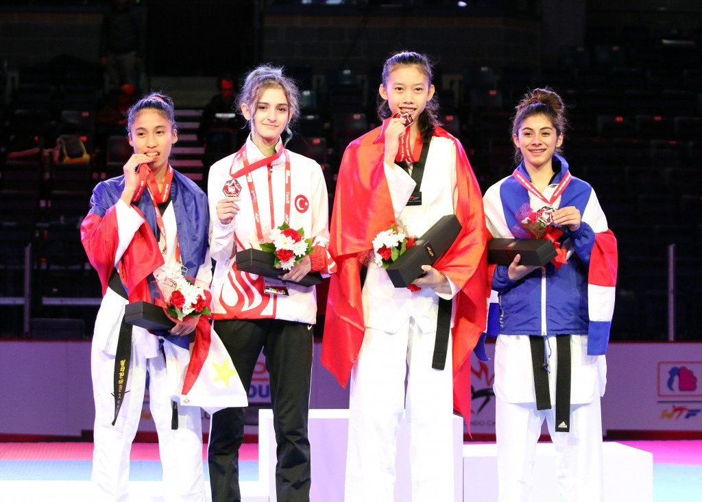 Vietnam's Thi Kim Ngan Ho, right centre, won gold in the women's under 44kg category, Costa Rica's Maria Calderon, right, took the silver and Philippines Babigail Faye Valdez, left, and Turkey's Derya Esme bronzes ©WTF