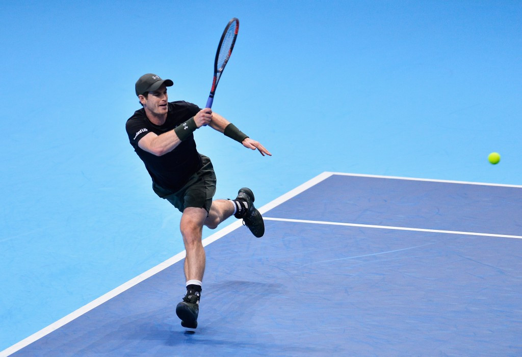 World number one Murray books place in last four of ATP World Tour Finals with victory over Wawrinka