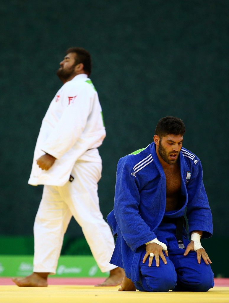 Or Sasson is left protrate on the mat after being thrown for an ippon in the men's heavyweight final ©Getty Images