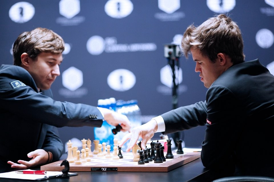 The World Chess Championship between Magnus Carlsen (right) and Sergey Karjakin remains level with one game to play ©FIDE