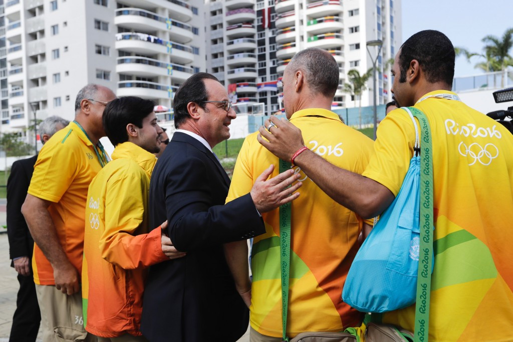 François Hollande pictured with volunteers while attending the Rio 2016 Olympic Games in August ©Getty Images