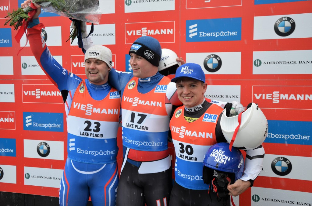 Tucker West (centre) recovered from disappointment to claim World Cup victory ©FIL