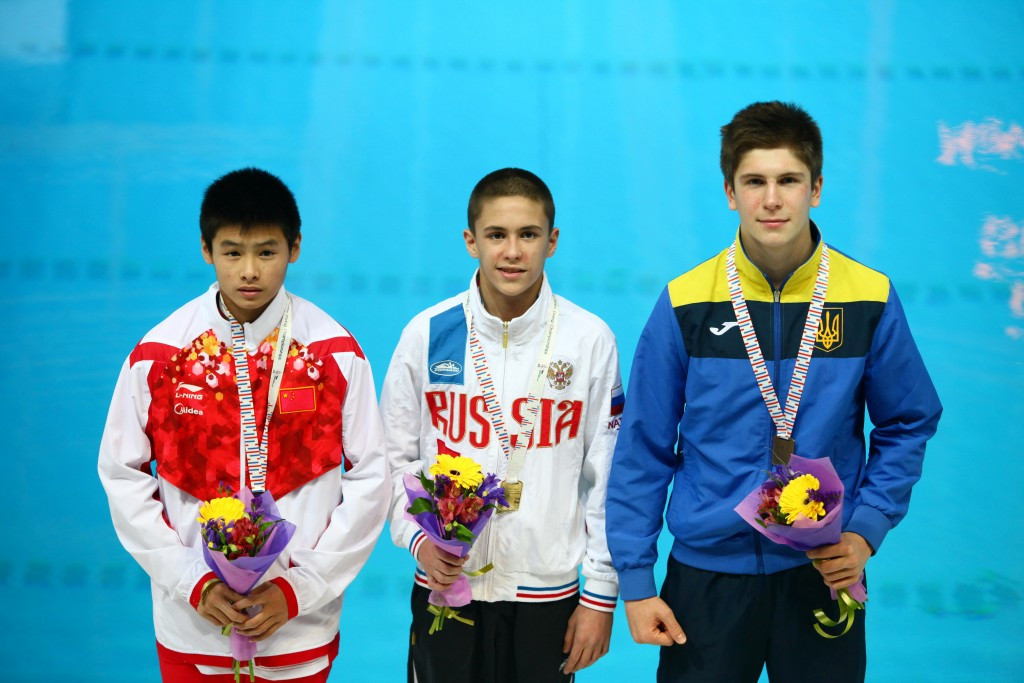 Ruslan Ternovoy (centre) secured hosts Russia's third gold medal of the 2016 FINA World Junior Diving Championships after claiming the boys B three metres springboard crown at the Aquatics Palace in Kazan ©FINA