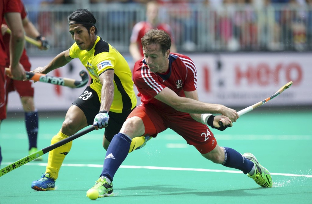 Britain came from behind to beat Malaysia and secure second position in Pool B